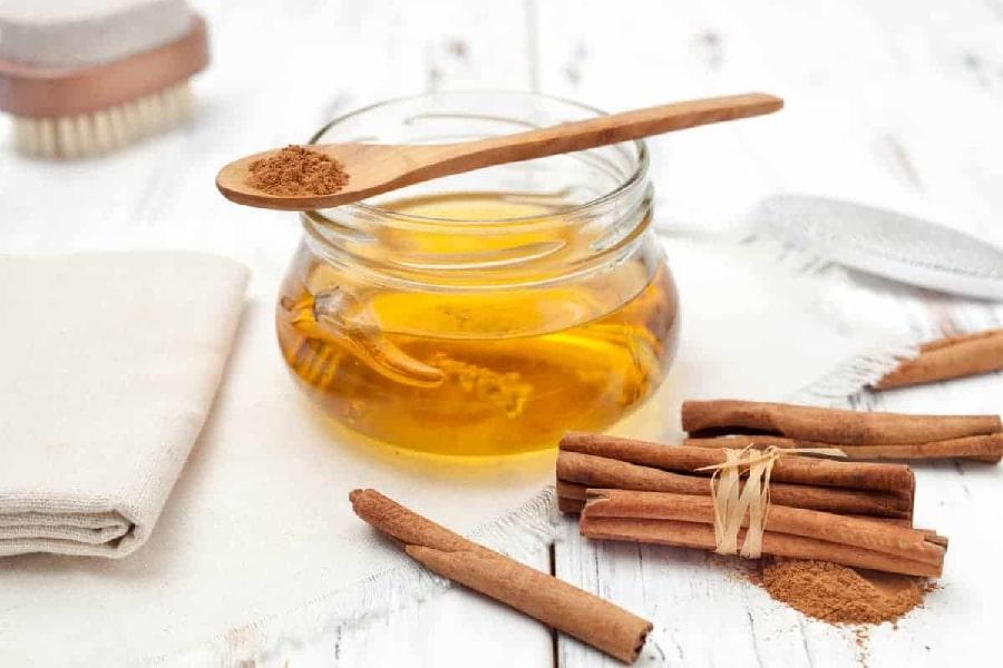 chữa đau dạ dày bằng mật ong cùng bột quế